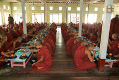Monks eating at Mahagandayon Monastery in Mandalay, Myanmar Stock Image