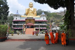 Monks in front of the Golden Temple, Dambulla, Sri Lanka Royalty Free Stock Images