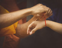 Monks giving blessings for peace & luck Royalty Free Stock Images