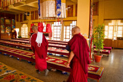 Monks of Gyuto monastery, Dharamshala, India. Tibetan Buddhist monks carry candles in the temple of Gyuto monastery, Dharamshala, India Royalty Free Stock Photos