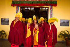 Monks of Gyuto monastery, Dharamshala, India. Tibetan Buddhist monks leaving a  ceremony, a yearly Puja inside the temple of Gyuto monastery, Dharamshala, India Stock Image