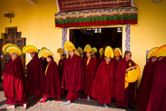 Monks of Gyuto monastery, Dharamshala, India. Tibetan Buddhist monks leaving a  ceremony, a yearly Puja inside the temple of Gyuto monastery, Dharamshala, India Royalty Free Stock Photo