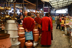 Monks inside a Chinese market Stock Photography