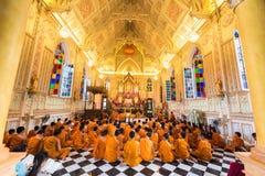Monks inside wat Niwet Thamma Prawat, Ayutthaya. Ayutthaya, Thailand - August 12, 2016: Many monks or priests inside Christian church style of Wat Niwet Thamma royalty free stock image