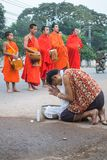 The monks of Laos. In Laos, where all people believe in Buddhism, a man must experience being a monk once in his life. Monks are a socially respected occupation Stock Photo