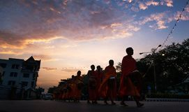 The monks of Laos. In Laos, where all people believe in Buddhism, a man must experience being a monk once in his life. Monks are a socially respected occupation Royalty Free Stock Photos
