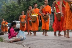 The monks of Laos. In Laos, where all people believe in Buddhism, a man must experience being a monk once in his life. Monks are a socially respected occupation Stock Photos