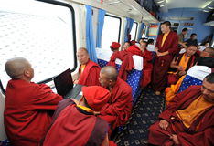 Monks with laptop in train. Tibetan monks going by train to Lhasa Royalty Free Stock Photos