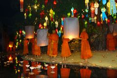 Monks launching flying candle during Loy krathong royalty free stock photography