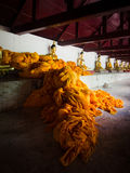 Monks laundry. Drapes and fabric are piled up to be washed in the Thai buddhist temple of Rachadamnoen Road Royalty Free Stock Photos