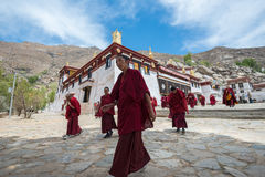 Monks leave the main assembly hall of Sera monastery Royalty Free Stock Photo