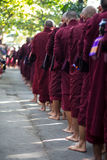 Monks lining up for lunch at Maha Gandaryon Monastery Royalty Free Stock Photography