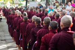 Monks lining up for lunch at Maha Gandaryon Monastery Stock Photography