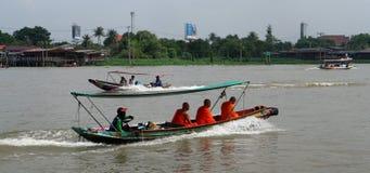 Monks on local speed boat. KO KRET, NONTHABURI, THAILAND - OCTOBER 24, 2018: Buddhist monks use local speed boat on Chao Phraya river on October 24, 2018 on Ko stock photography