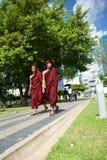 Monks at Mahabandoola Garden. Young monks at Mahabandoola Garden, Yangon, Myaynar Royalty Free Stock Images