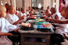 Monks in Mahagandayone monastery Stock Photo