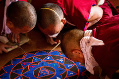 Monks making a Mandala Gyuto monastery, Dharamshala, India. Tibetan Buddhist monks making a Mandala in the temple of the Gyuto monastery, Dharamshala, India Royalty Free Stock Photography