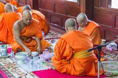 Monks in merit making Stock Image