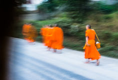 Monks in motion blurr Stock Photography