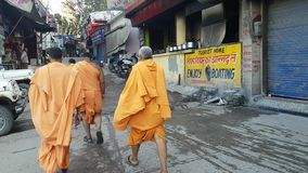 Monks with Orange Robes Walking in Street India stock video
