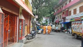 Monks with Saffron Robes in Durga Puja Rishikesh. Monks with Orange Robes Walking in Street India stock footage