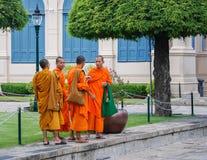 Monks Outside King's Palace Stock Photo