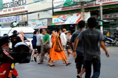 Monks and pedestrians Royalty Free Stock Photo