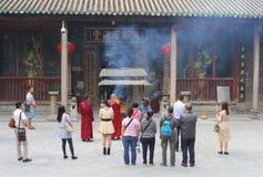 Praying Buddhist monks and devotion, Hualin temple, Guangzhou, China Royalty Free Stock Image