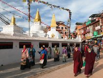 Monks and peoples walking around Bodhnath stupa - Nepal Royalty Free Stock Photo