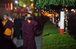 Monks-pilgrims make evening kora. Royalty Free Stock Image
