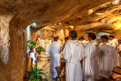 Monks pray in Grotto of Gethsemane. Royalty Free Stock Images