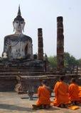 Monks praying. Buddist monks praying in front of buddha Royalty Free Stock Photos