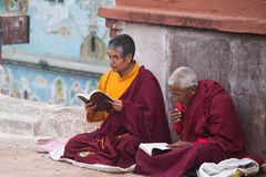 Monks praying at Bouddanath temple in Kathmandu Royalty Free Stock Photography