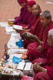 Monks praying at Bouddanath temple in Kathmandu Stock Images