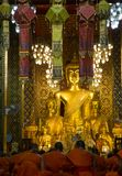 Monks praying in main hall at Lamphun temple royalty free stock images
