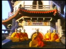 Monks praying on steps in front of shaolin temple stock footage