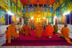 Monks praying in temole Royalty Free Stock Photo