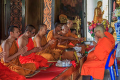 Monks praying in Wat Kaew Korawaram Temple Stock Photography
