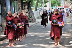 Monks Prepare to Eat Lunch Royalty Free Stock Photography
