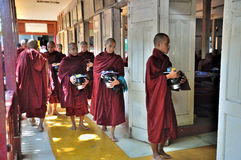 Monks Prepare to Eat Lunch royalty free stock photo
