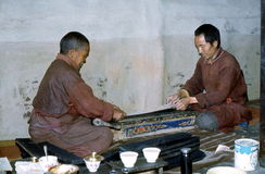 1977. India. Buddhist monks printing a scripture. The Picture shows 2 monks at Kardang Gompa Stock Photo
