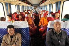 Monks and regular passengers Stock Photos