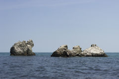 Monks rocks in the Black Sea. Four figured rocks in the sea under clear blue sky without clouds and sun. View from the coast, nobody around the Black Sea, Crimea Stock Image