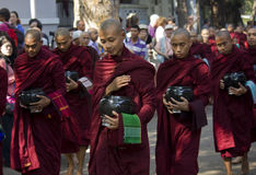Monks in a row for lunch: Mahagandayon Monastery Royalty Free Stock Photos