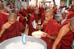 Monks in a row at Mahagandayon Monastery Royalty Free Stock Images