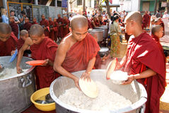 Monks in a row at Mahagandayon Monastery Stock Images