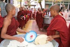 Monks in a row at Mahagandayon Monastery Royalty Free Stock Photo