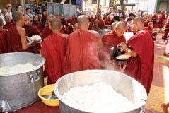 Monks in a row at Mahagandayon Monastery on Mandalay Royalty Free Stock Image