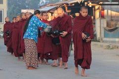 Monks in a row Stock Photos