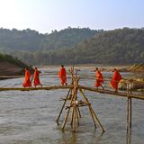 Monks on a rustic bridge stock photos